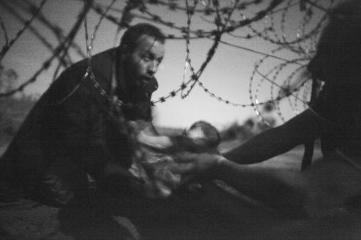 World Press Photo of the Year winning entry, Hope for a New Life by Warren Richard.